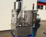 Rotacyjna maszyna napełniająco – zamykająca Hugart DS 2500 #1