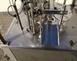 Rotacyjna maszyna napełniająco – zamykająca Hugart DS 2500 #8
